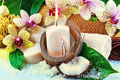 Spa concept with candle, coconut, orchid