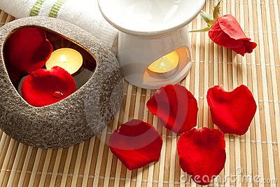 Spa Concept: Rose petals, aroma candles