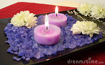 Spa essentials (violet salt, candles and flowers)