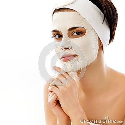 Spa Mask. Woman in Spa Salon. Face Mask. Facial Clay Mask.