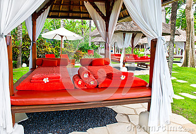 Spa massage bed with red towels