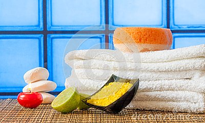 Spa massage border background with towel stacked red candle stone and lime