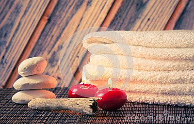 Spa massage border background with towel stacked stone and red candles