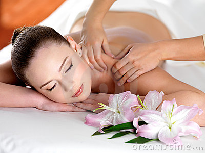 Spa massage on a shoulder of woman