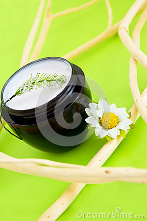 Spa moisturising product with flower and branches