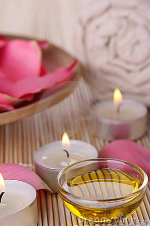 Free Spa Products With Rose Petals, Oil, Towel Stock Photo - 5625450
