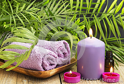 Spa scented candles essential oil and towels stock photo for Spa smelling candles