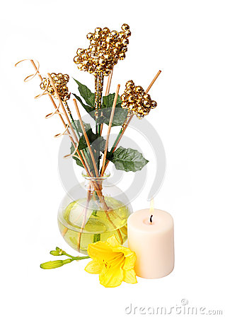 Spa setting with aroma sticks, candle, and flower