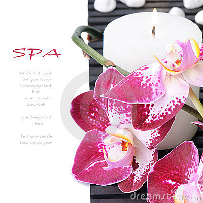 Spa setting with purple orchid and candle