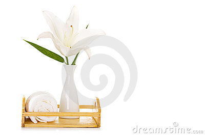 Spa setting with white lily