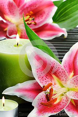 Spa still life with candle and pink lilies