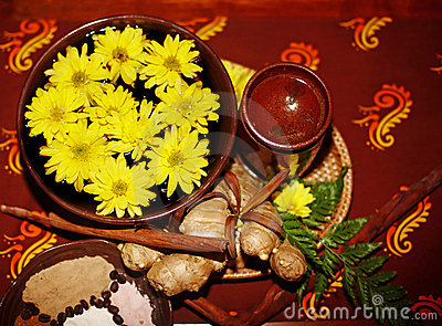 Spa still life with flower on brown background.