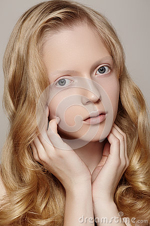 Spa, wellness & healthcare. Beautiful girl model with clean skin, curly blond hair