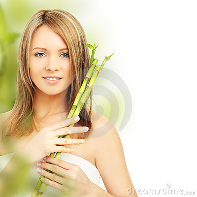 Spa woman with bamboo