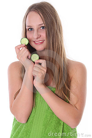 Spa woman with green cucumber facial mask
