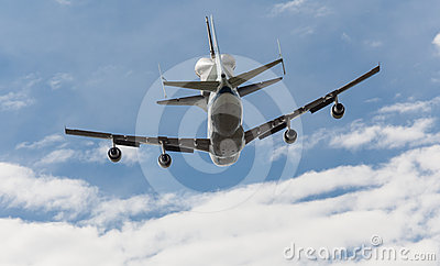 Space Shuttle Discovery flies over Washington Editorial Photo