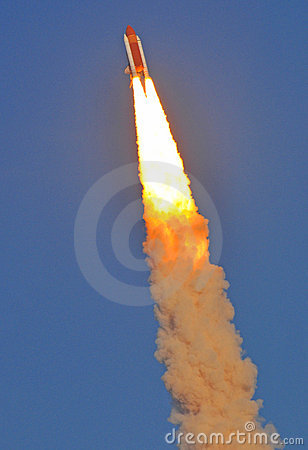 Space Shuttle Discovery Streaking Across the Sky Editorial Stock Photo