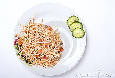 Spagetti with vegetables on the white plate
