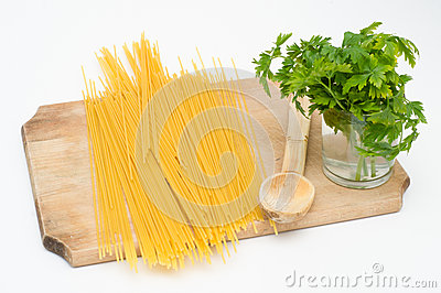 Spaghetti on wood board with wood spoon