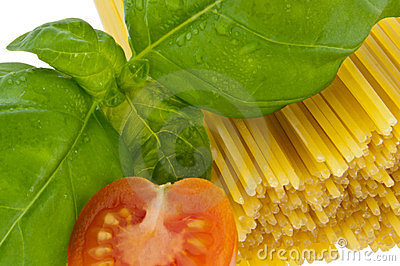 Spaghetti with basil and tomato - macro view