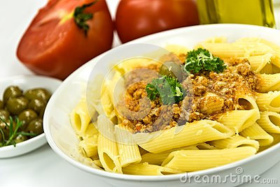 Spaghetti bolognese with parmesan cheese and olive