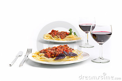 Spaghetti bolognese with two glasses of wine
