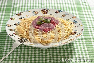 Spaghetti dish with tomato sauce