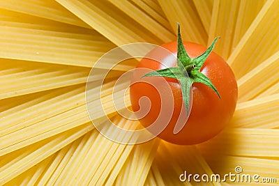 Spaghetti and a fresh tomato
