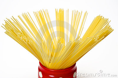 Spaghetti inside a red jar closeup
