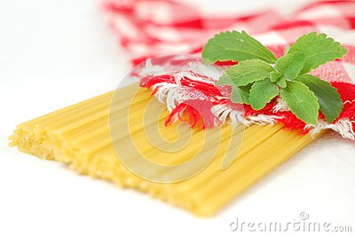 Spaghetti pasta and green stevia herb