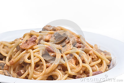 Spaghetti pasta with mushrooms sauce isolated
