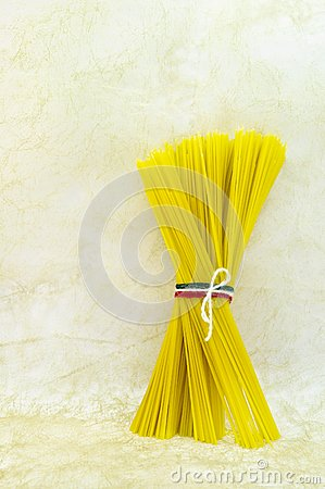Spaghetti pasta tied in a bunch with string