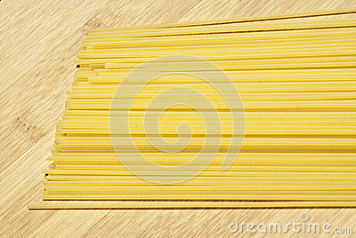 Spaghetti on wooden board