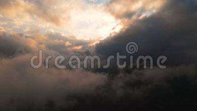 Span camera through the evening rain clouds at sunset above cloud levels. Fabulous flight in the clouds. Aerial view.  stock footage
