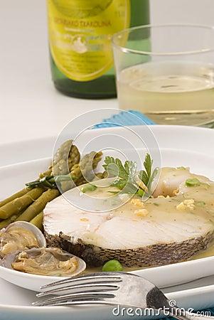 Spanish cuisine. Hake Basque style.