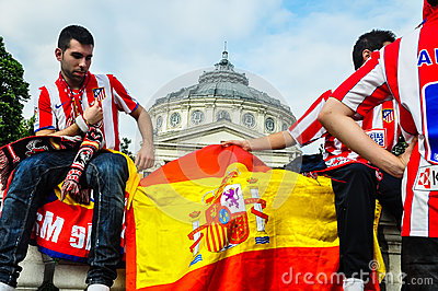 Spanish fans celebrating near Romanian Atheneum Editorial Stock Photo