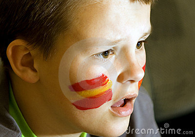 Spanish flag on face of boy