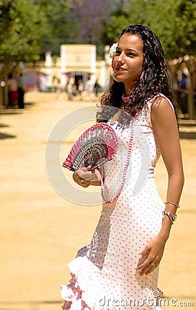 Spanish Girl in Feria Dress fans herself