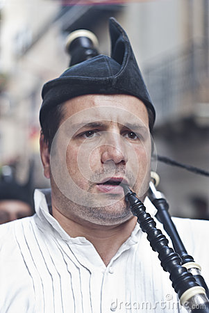 Spanish man playing bagpipes Editorial Stock Image