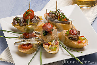 Spanish tapas. Bread slices mounted with tuna.