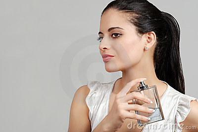 Spanish woman spraying perfume