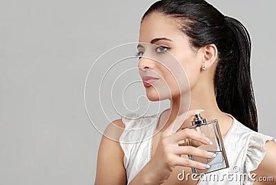 Spanish woman spraying perfume