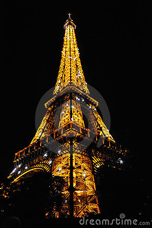 Sparkling Eiffel Tower at midnight Paris Editorial Stock Photo