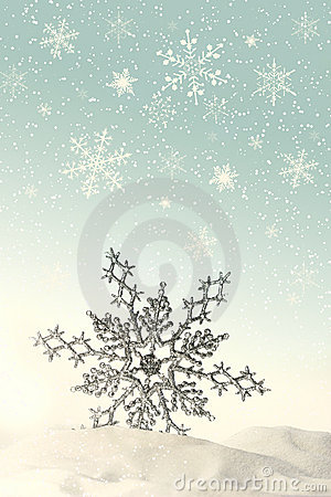 Sparkling snowflake in the snow