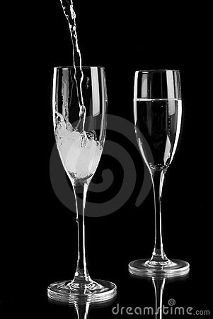 Free Sparkling Wine Poured Into Champagne Flutes Stock Image - 9422001