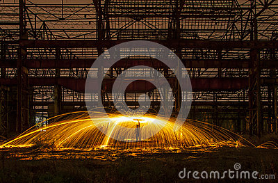 Sparks of steelwool in an abandoned warehouse