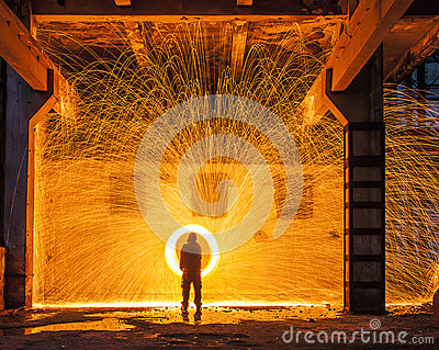 Sparks of steelwool in an industrial hall