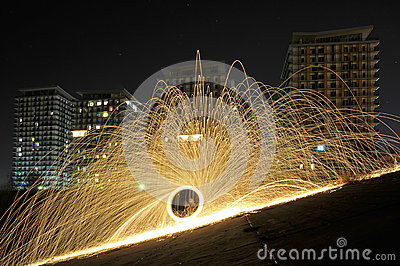 Sparks of steelwool near a residential project