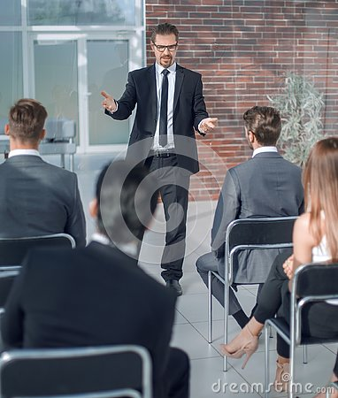 Free Speaker Makes A Report At The Business Seminar. Stock Image - 130471841