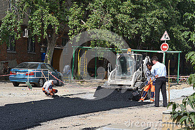 Special equipment on road repair. Asphalt laying. Editorial Stock Photo